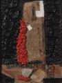 Cretto nero con sacchi e trucioli