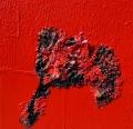 Plastica rossa combusta e quarzo