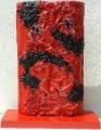 Plastica rossa combusta e pietre, lato a